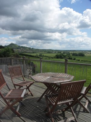 the deck at Healing Waters with a view of the Tor